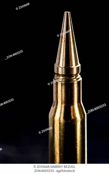 Top of the rifle cartridge on a dark background