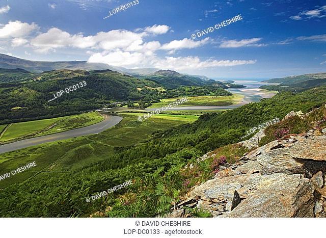Wales, Gwynedd, Mawdach Estuary, A view toward the Mawddach Estuary. Morfa Mawddach is a beautiful estuarine valley that begins it's journey in the heart of...