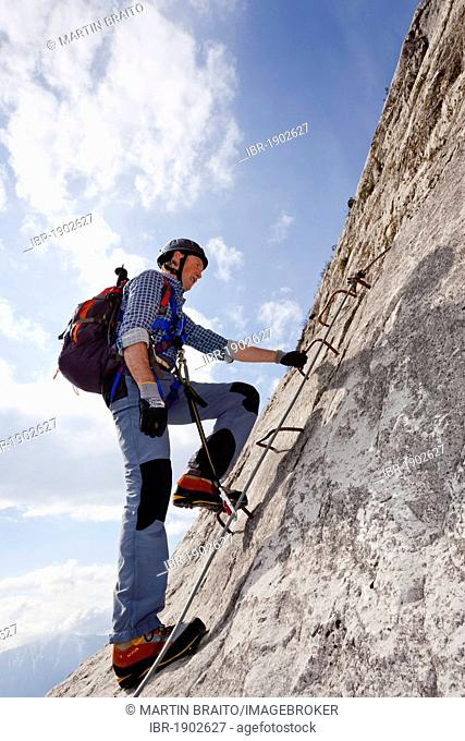 Climber on the Che Guevara fixed rope route on Mt. Monte Casale in the Sarca Valley, Lake Garda region, Trentino, Italy, Europe