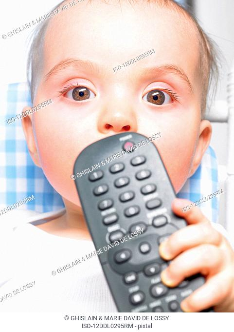 Baby holding a remote control