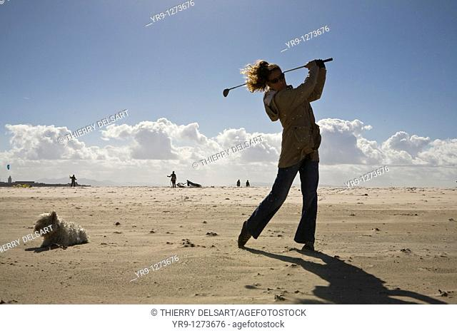 Golf training doesn't have to be on a green. An uncrowded beach in winter is actually a perfect place to do it. It even has its special appeal for its weirdness