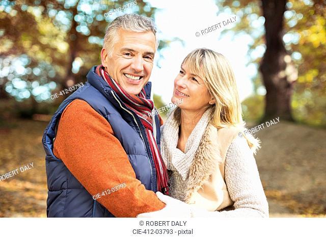 Older couple smiling together in park
