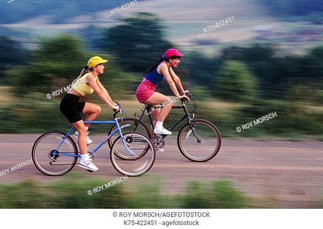 Two women biking