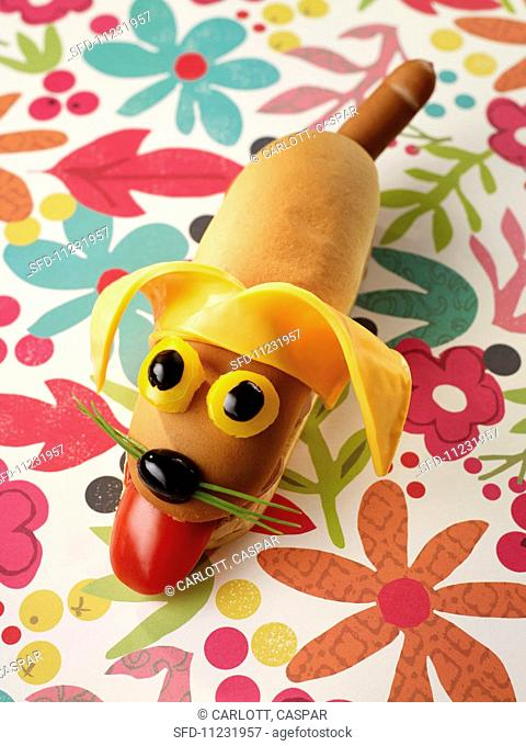 A hot dog with a smiling dog's face