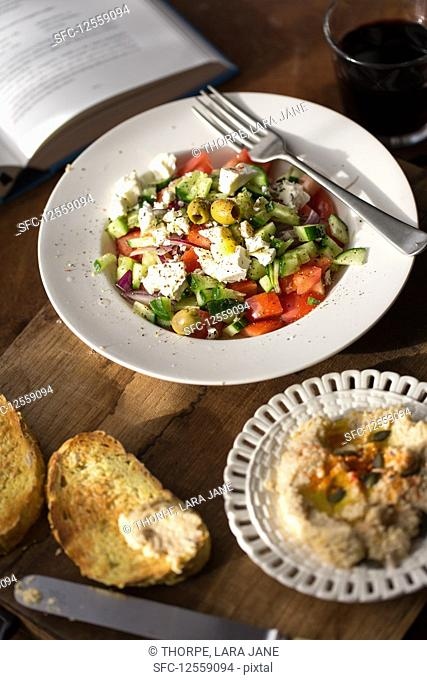 Greek salad with hummus and toasted bread