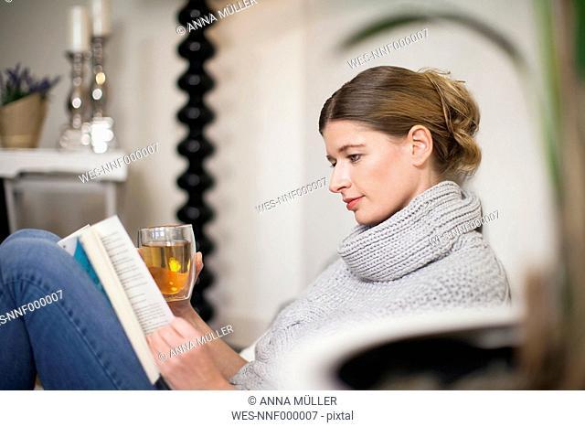 Portrait of reading woman enjoying Sunday morning at home