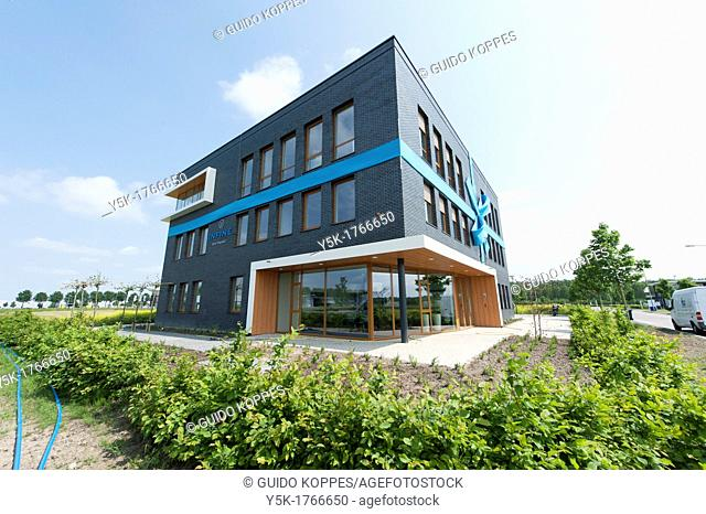 Zeewolde, Netherlands. Exterior of a new office-building of a software company on a industrial estate. With noose or snare strapped around