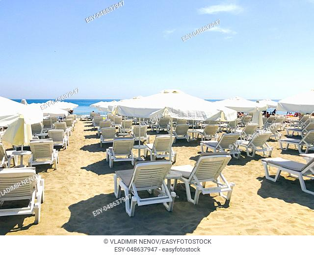 White Loungers And Umbrellas At The Beach In Pomorie, Bulgaria