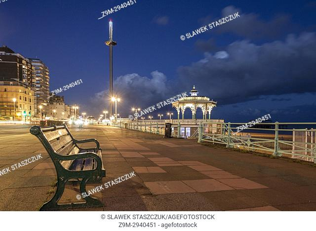 Night falls on Brighton seafront, East Sussex, England. Brighton Bandstand in the distance
