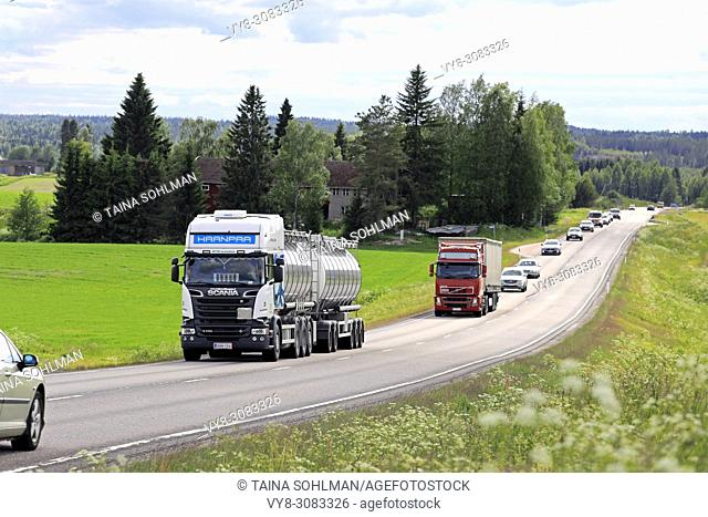Road landscape of Highway 9 in summer with truck and car traffic. Jamsa, Finland - June 14, 2018