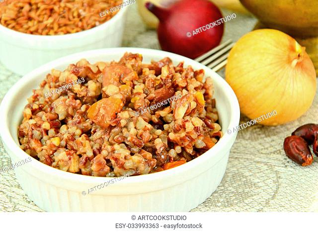 Healthy Food: Pilaf with Meat and Red Rice. Studio Photo