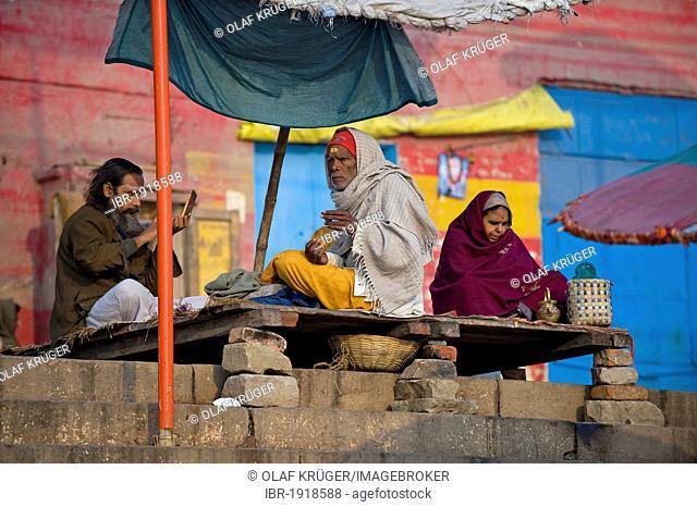 Men at the Ghats or holy stairs, Ganges, Varanasi, Uttar Pradesh, India, Asia