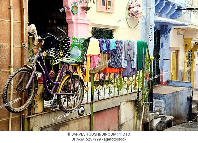 cycle hanging on railing outside house jodhpur rajasthan India Asia