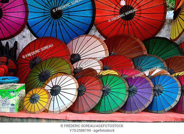 Colorful handmade Asian umbrellas on display at night market in Luang Prabang, in Laos, South East Asia