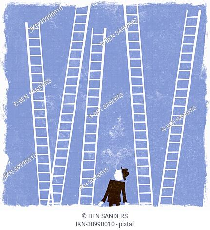 Businessman looking up at ladders