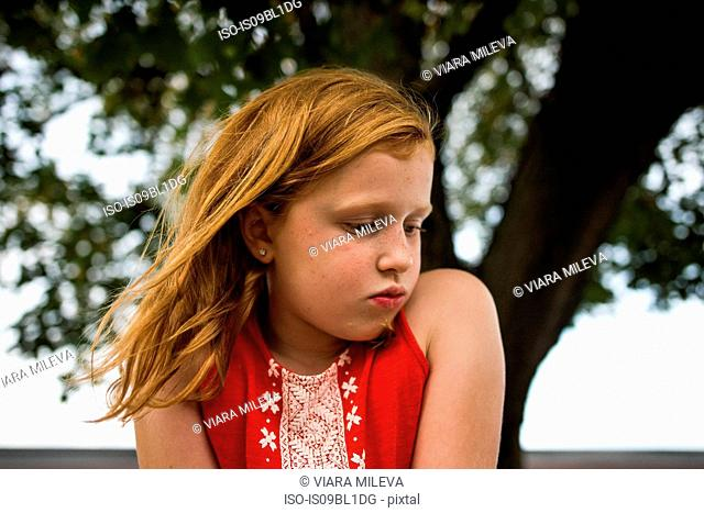 Girl puckering by tree