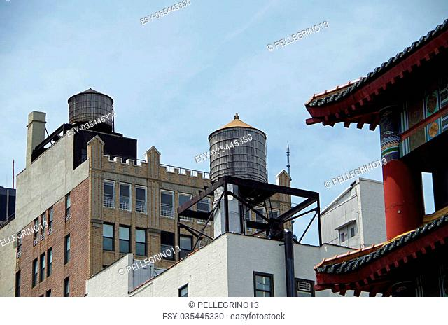 Water towers and buildings seen from street in nyc
