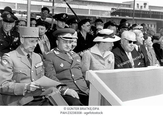 (L-r) French town major General Geze, assistent Soviet town major Colonel Kotsiuba, and assistant head of the Berlin US mission Bernard Gufler (with sunglasses)...