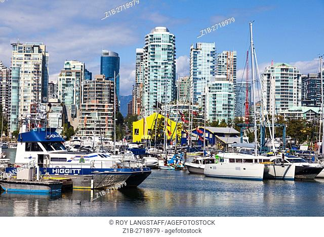 Marina in False Creek with the skyline of the Yaletown district of Vancouver as a backdrop