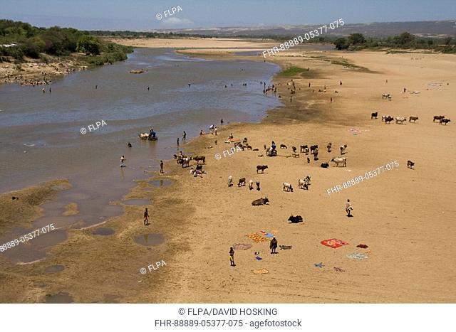 The River Mandrare at Amboasary, Madagascar Local people washing cloths and collecting water