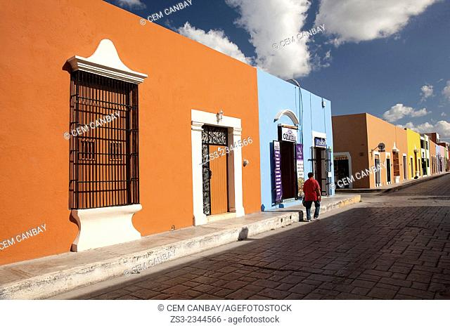 Man walking in the street at the historic center of Campeche, Campeche Region, Yucatan, Mexico, Central America