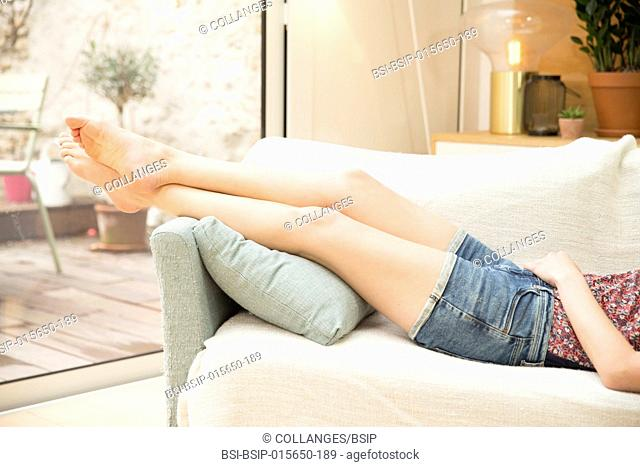 Woman relaxing on her sofa