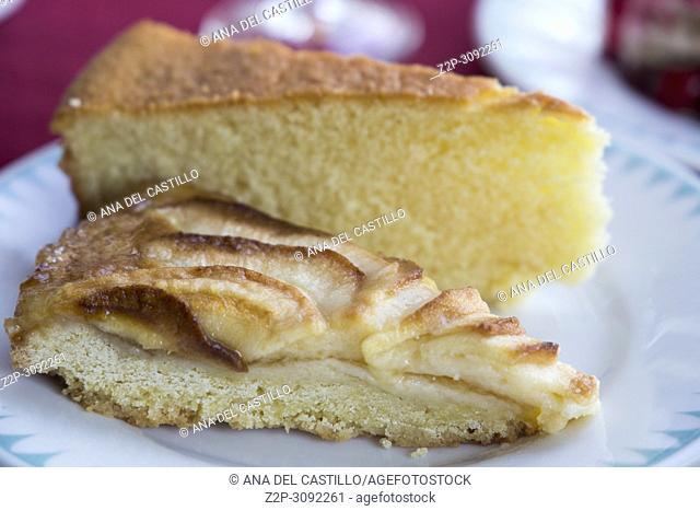 Apple tart and sponge cake on plate
