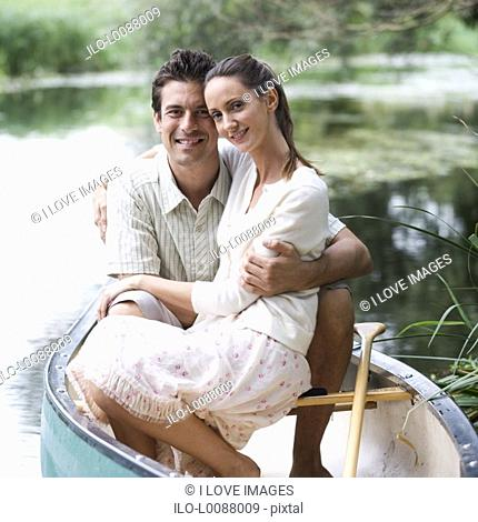 Young couple in a rowing boat