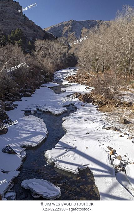 Golden Colorado - Clear Creek, partially frozen in winter. The creek flows from the Continental Divide in the Rocky Mountains through Clear Creek Canyon to the...