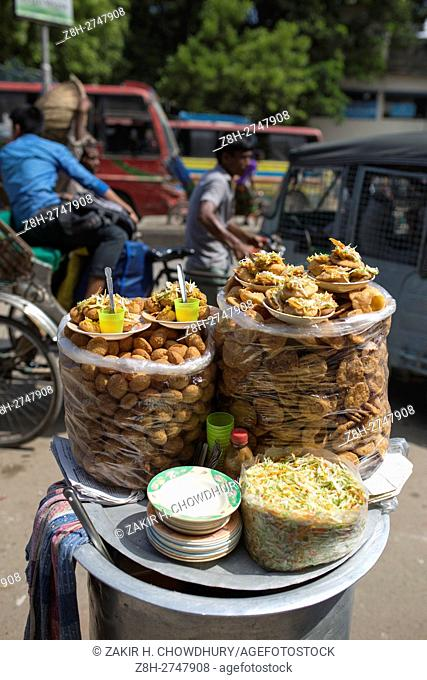 DHAKA, BANGLADESH - OCTOBER 15 : A vendor sell food on street in Dhaka, Bangladesh, on October 15, 2016. . Most of time food are being prepared with unhygienic...