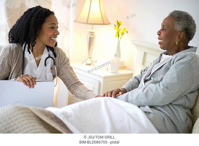 Nurse giving woman checkup
