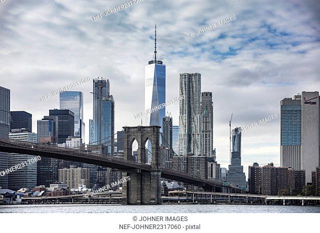 Urban skyline with One World Trade Center and Brooklyn Bridge, New York City, USA