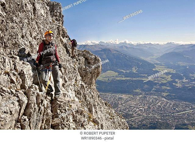 Two female alpinists rock climbing, Innsbruck route, Tyrol, Austria