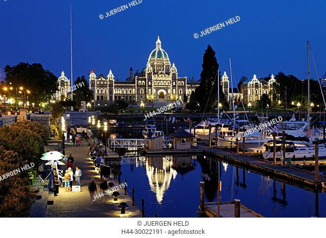 Victoria harbour and illuminated parliament at twilight in Victoria, Vancouver Island , Canada, North America