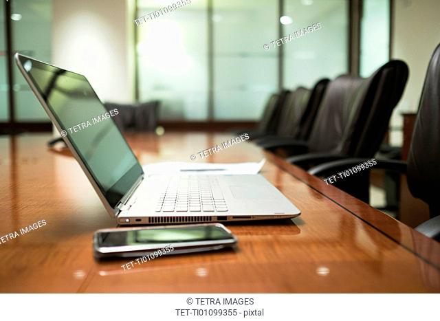 Empty conference table with mobile devices