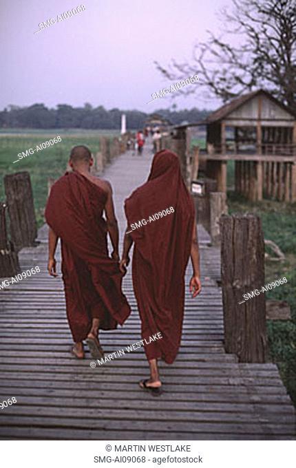 Myanmar (Burma), Mandalay, Buddhist monks crossing the U Bein bridge
