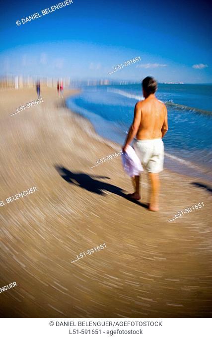 Man walking on Malvarrosa beach, Valencia. Comunidad Valenciana, Spain