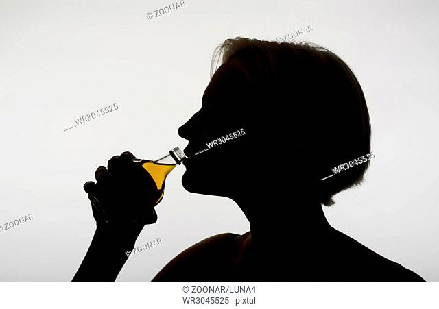 woman drinking whiskey