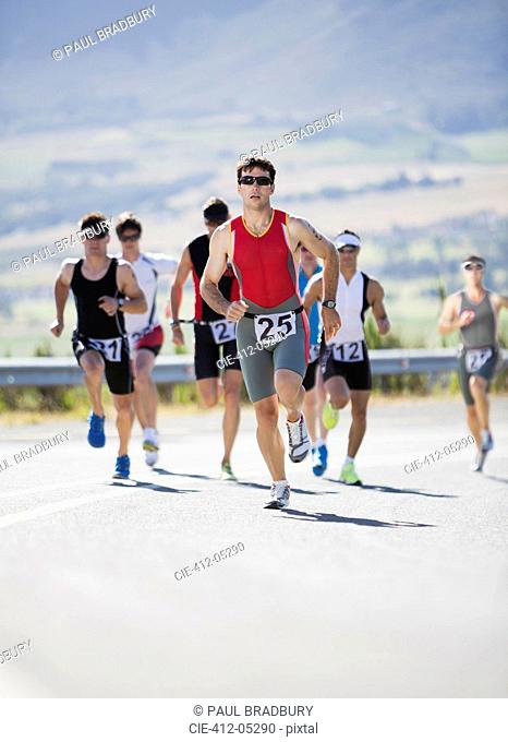 Runners in race on rural road