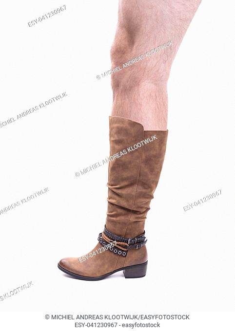Women's high leather boot with a hairy man's leg isolated on white background