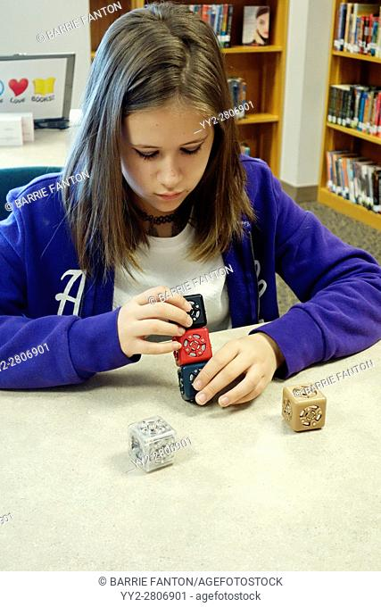 7th Grade Girl Working With Robot Cubes, Wellsville, New York, USA