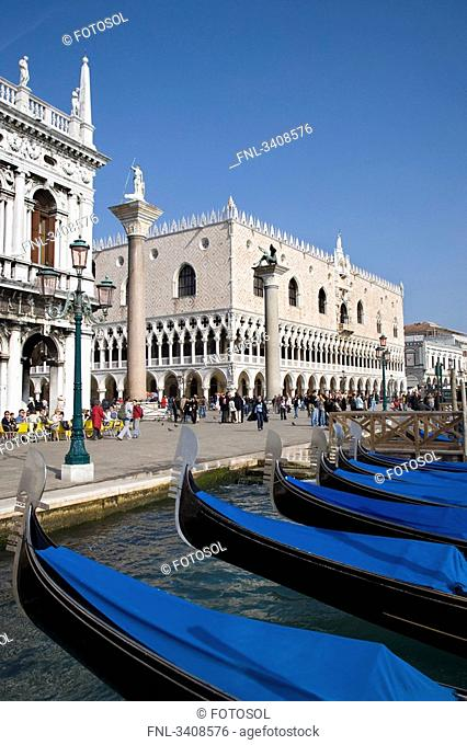 Gondolas in front of a seaside promenade, Venice, Italy