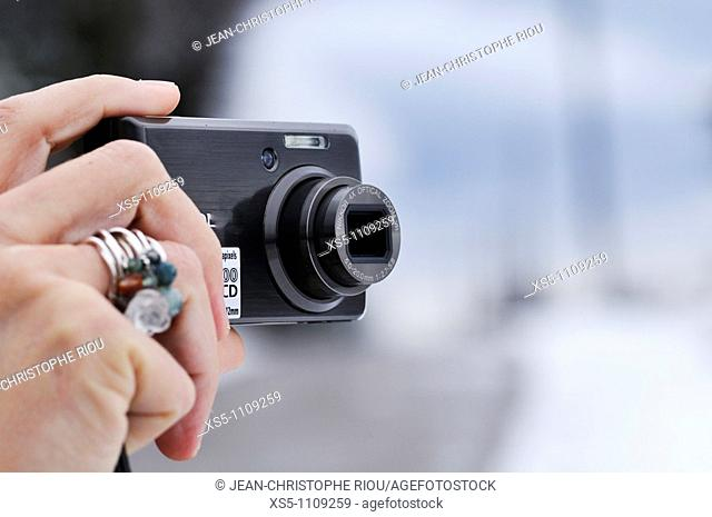woman holding a digital camera