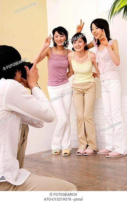 Man taking a picture of girlfriends