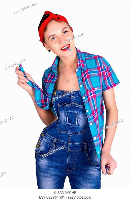 Beautiful young leggy blondy girl in a red bandana, denim overalls and a plaid shirt, licking candy. isolated on white background