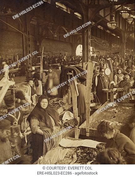 Vendors selling fish at a market in New York City's. ca. 1890-1910. BSLOC-2010-18-109