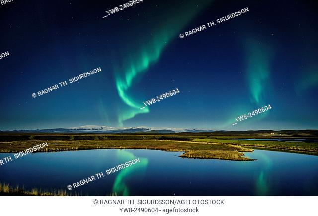 Northern lights with moonlight over the Skafta river, near Kirkjubaejarklaustur village, Iceland
