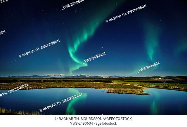 Northern lights with moonlight over the Skafta river, near Kirkjubaejarklaustur village, Iceland