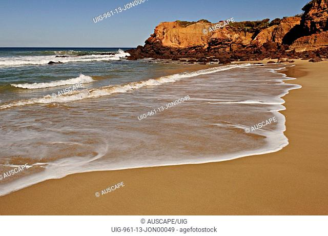 Waves washing onto beach, Point Addis Marine National Park, near Anglesea, Victoria, Australia