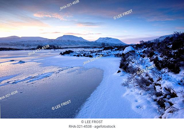 Dawn view of frozen Loch Ba on snow-covered Rannoch Moor, Highland, Scotland, United Kingdom, Europe